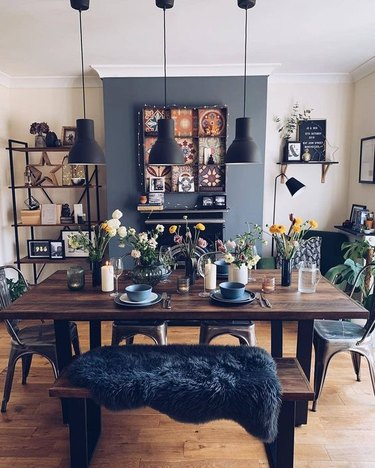boho industrial dining room idea with blue accent wall
