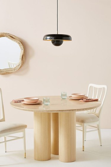 Contemporary dining room lighting idea with ceiling fixture over wood table