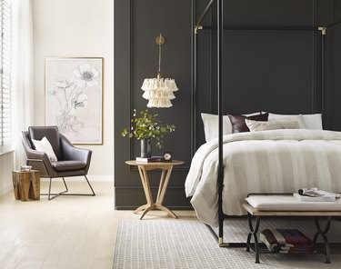 sherwin-williams urbane bronze paint color in bedroom with canopy bed, nightstand, and armchair