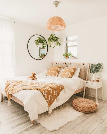 bohemian bedroom lighting idea with woven pendant above bed