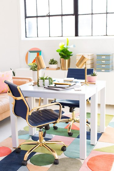 white contemporary office with colorful furniture