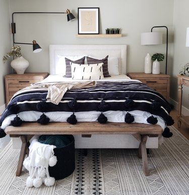 bohemian bedroom lighting idea with floor lamp and wall sconce