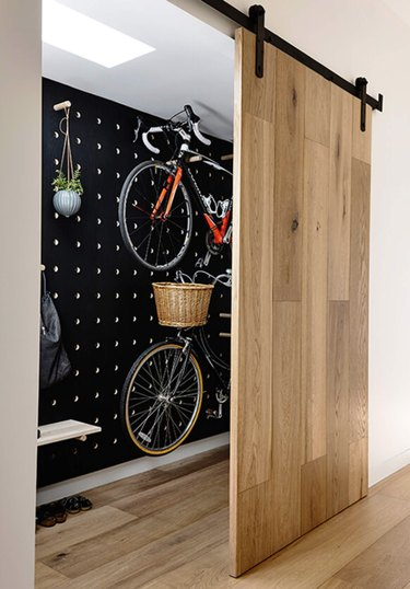 Light wood Contemporary Barn Doors, bicycle storage, skylight.