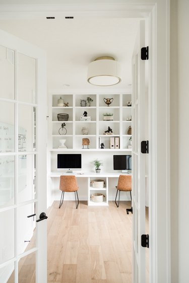white Contemporary Office with double desk and open shelving