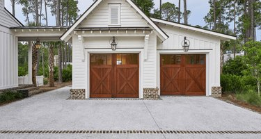 Cherry wood barn garage doors with white exterior