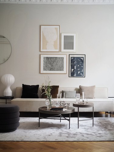 Warm living room color idea with greige sofa, rug and warm cushions