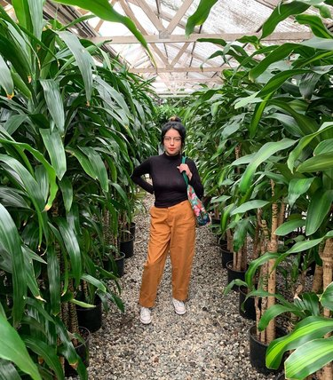 person standing amidst plants