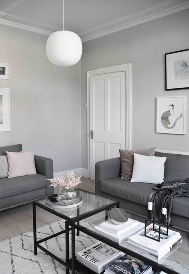 living room lighting idea with white lantern in gray living room