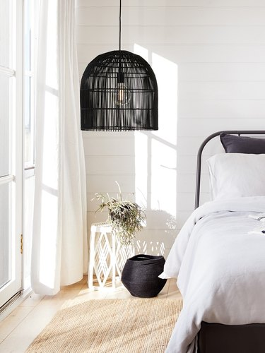 bedroom lighting idea with oversize rattan pendant at bedside