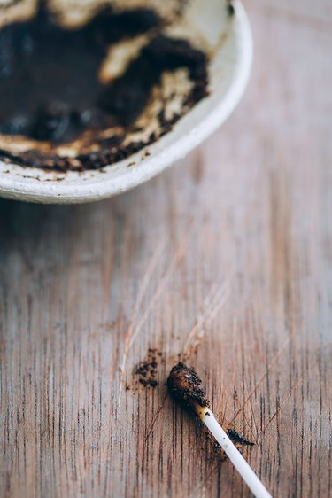 Fix wood scratches with coffee grounds