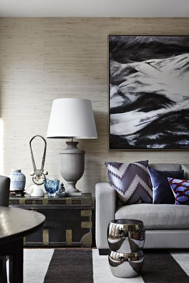living room color idea with textured greige wallpaper in chic living room