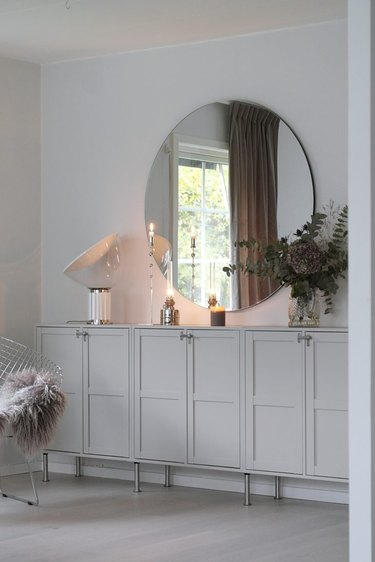 Greige living room color idea with console and large mirror