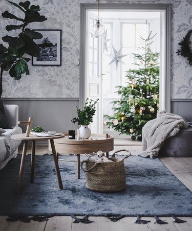 blue and gray Christmas colors in living room with christmas tree in the back