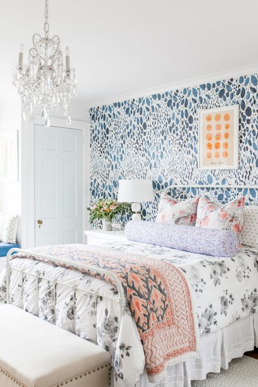country bedroom idea with modern bedroom with floral bed linen and patterned wallpaper