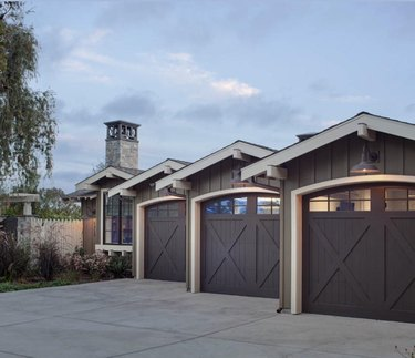 Dark brown barn garage doors showcased on modern farmhouse exteriors