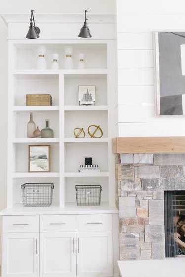 farmhouse living room lighting idea with industrial wall sconces