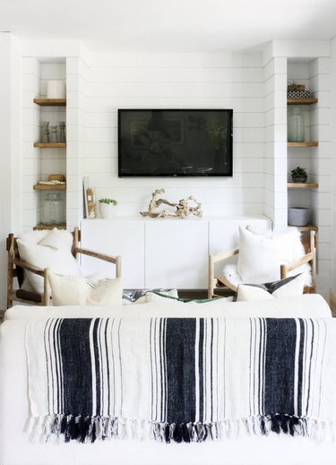 House Seven Design living room with shiplap walls