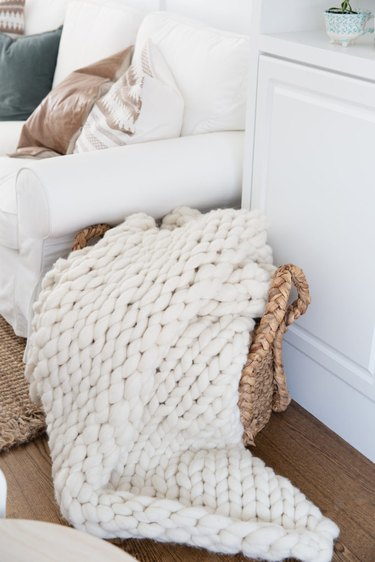 small living room idea for storage with basket for blankets