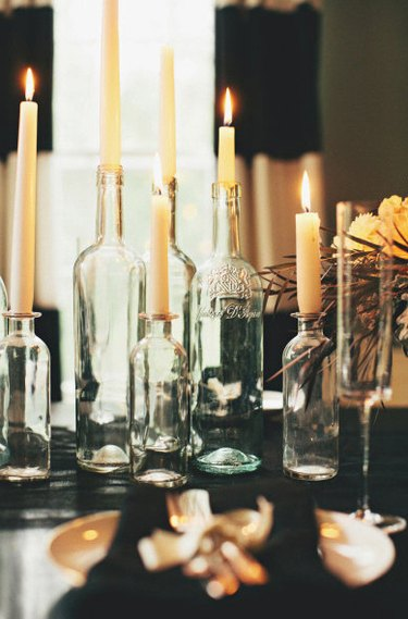 repurposed wine bottles turned into candleholders