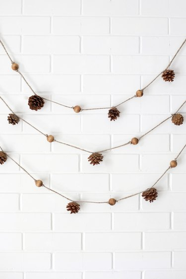festive fall pine cone and wooden bead garlands
