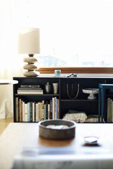 small living room idea for storage with bookshelf under window living room storage ideas