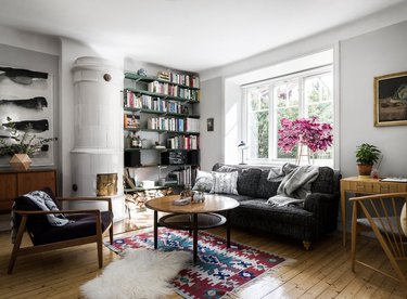 small living room idea for storage with floor-to-ceiling open shelving