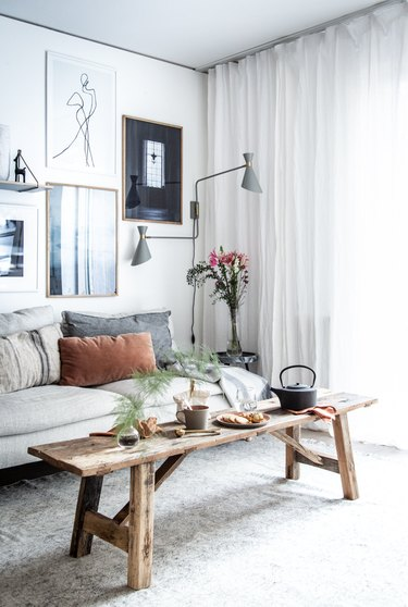 Statement floor lamp and gallery wall in Scandinavian living room