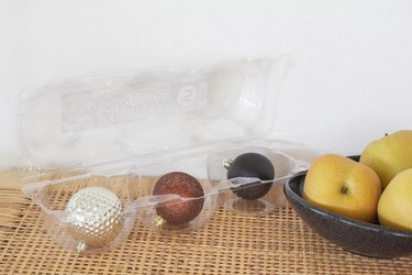 Ornaments stored inside apple container