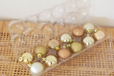 Small ornaments stored inside egg carton