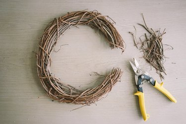 Three-inch segment cut off of grapevine wreath with garden shears