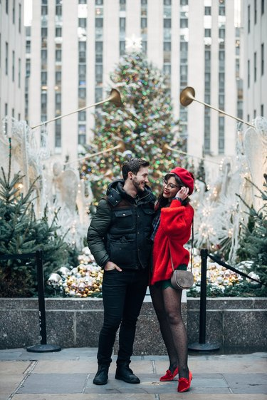 professional holiday photos in front of Christmas tree