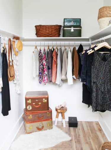 bedroom closet idea with clothes hanging on rod and peg rail for accessories and shelving for baskets