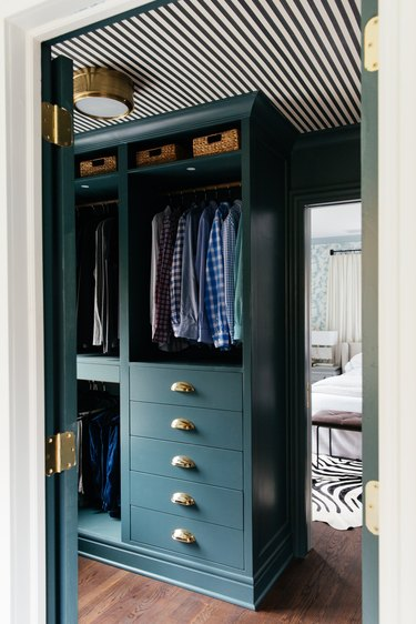 Ikea Hack bedroom closet idea by Erin Kestenbaum with green cabinetry and striped ceiling