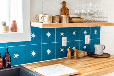 kitchen idea with wood countertops and open shelving with blue backsplash