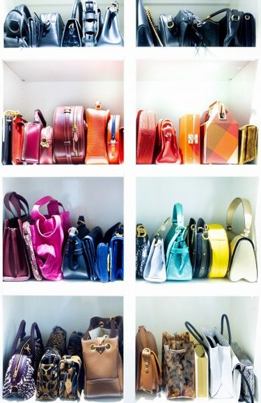 bedroom closet idea with shelving for handbags organized by color