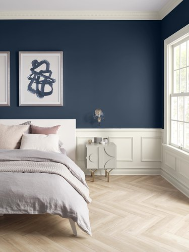 bedroom with navy walls and white trim