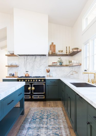 bohemian inspired kitchen with teal lower cabinets