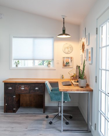 Garage office with corner desk and pendant light