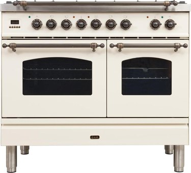 Double oven stove with vintage-inspired details in cream