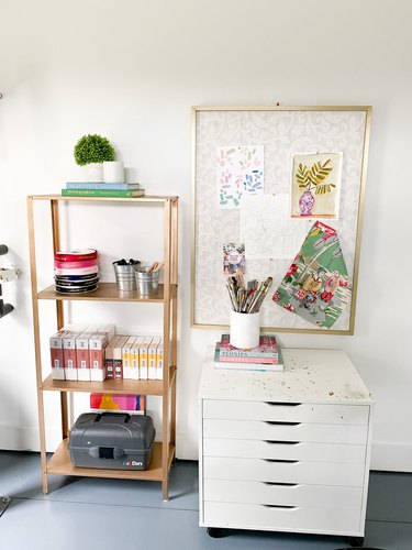 Garage office with white filing cabinet and gold shelf