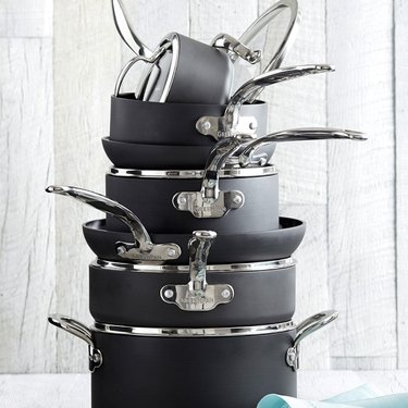 Black and silver ceramic cookware set shown in a stack