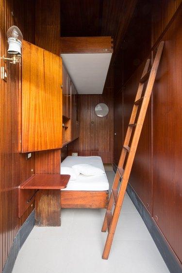 bedroom with wood walls
