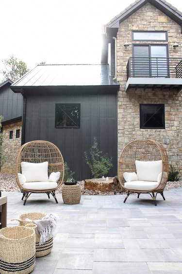 Contemporary home exterior with mix of black siding and stonework