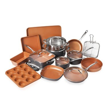 Rust-colored ceramic cookware set with baking accessories