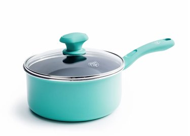 Turquoise ceramic pans with glass lid.