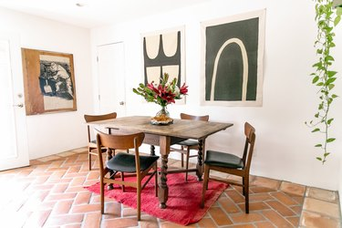 dining room with tile floor, hanging plant, wood dining table