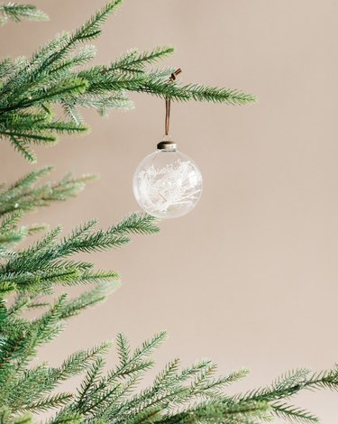 glass ornament with white grass