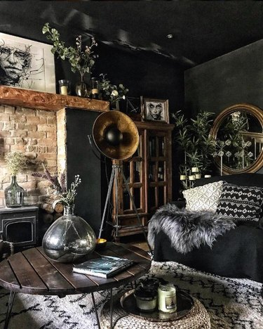 black living room color idea with rustic accessories