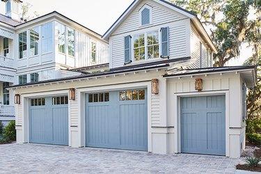 blue craftsman style garage door on white house