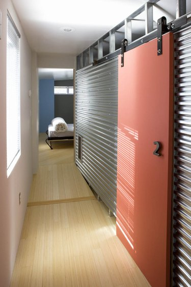 Coral Contemporary Barn Doors on galvanized steel walls.